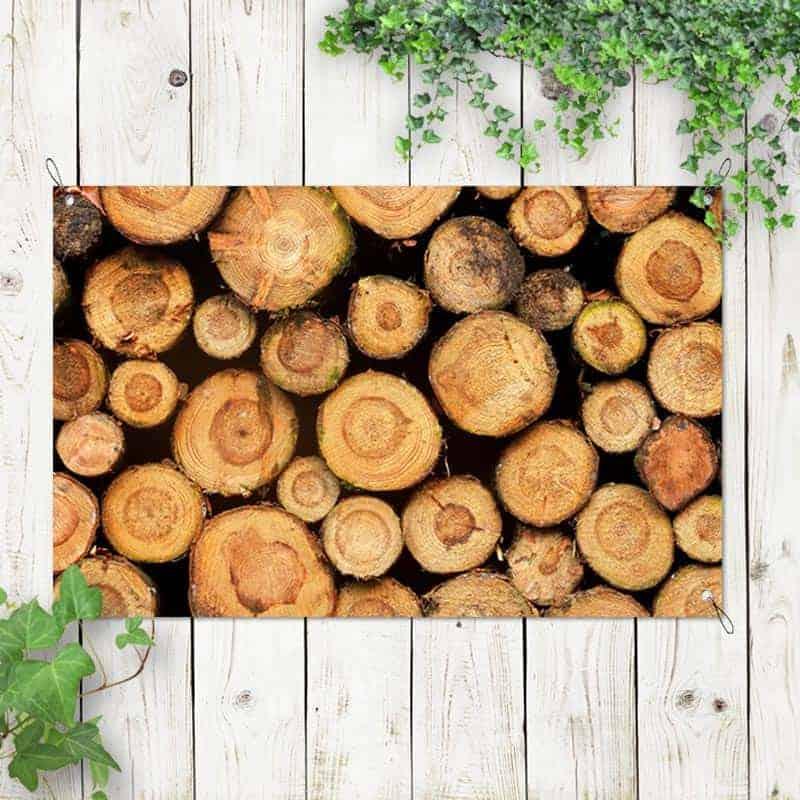 Tuinposter Gestapelde boomstammen 1