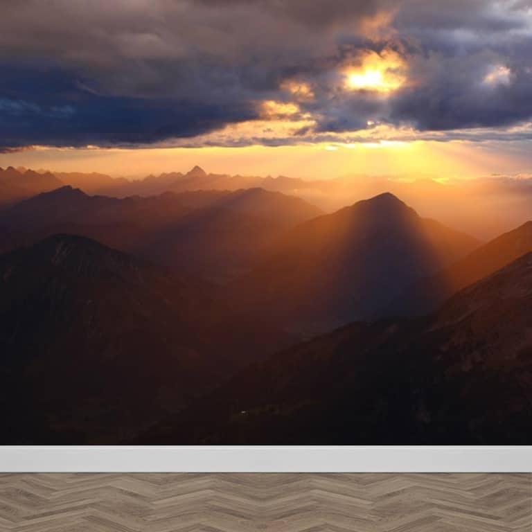 Fotobehang zonsondergang in de bergen