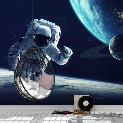 Fotobehang astronaut bij aarde